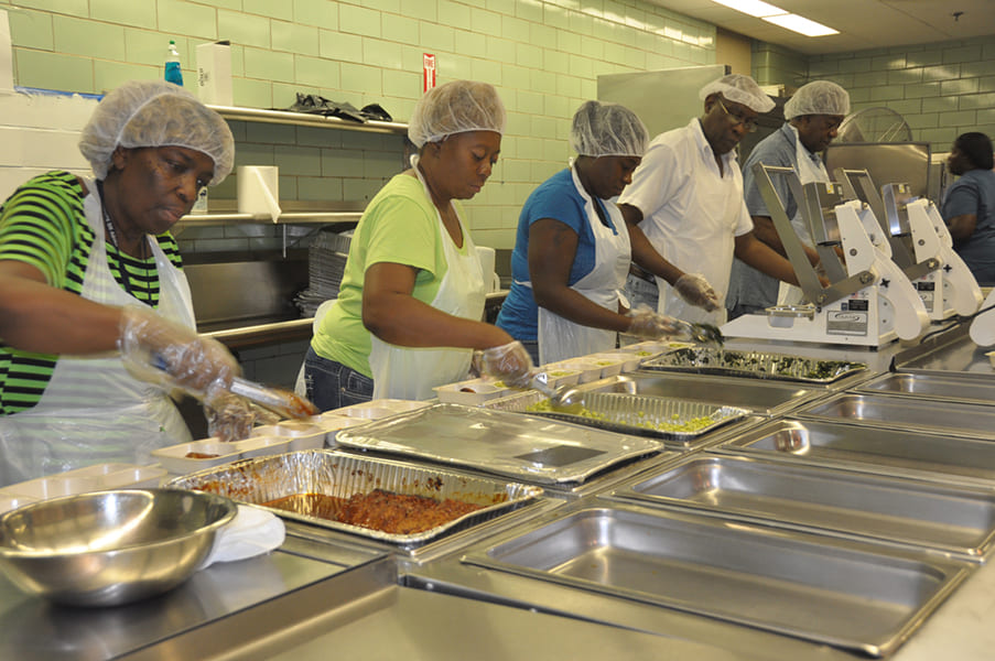 Rose Centers staff packaging home-delivered meals